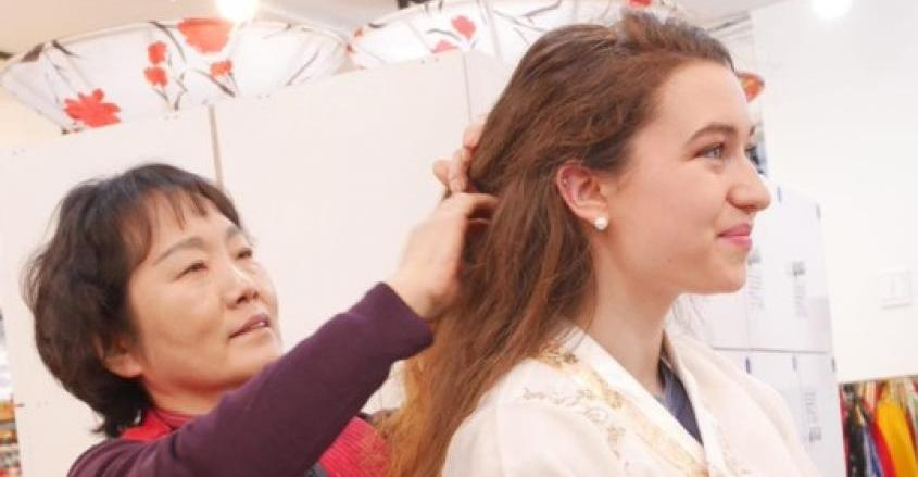 Student with woman who helped fix hair and explain traditional Hanbok.