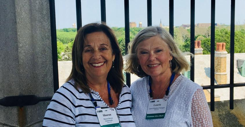 Class of '74 roommates Sharon Brown Sobolewski (L) and Laurie Bracken Flanagan (R) enjoy the spectacular views from the Le Mans Bell Tower during their tour Reunion Weekend.