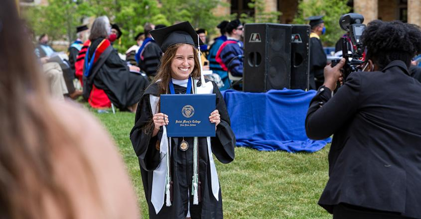 Graduate showing off her diploma