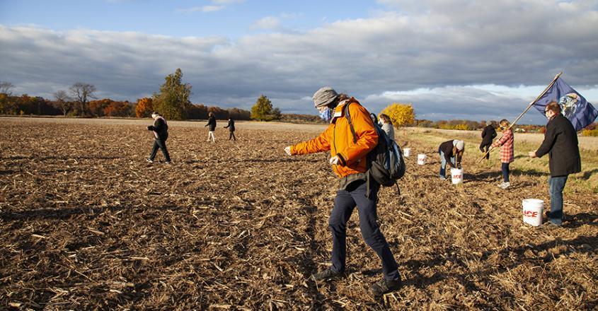 Professor Christopher Cobb sows winter rye seeds
